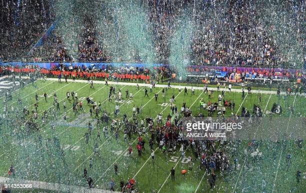TOPSHOT The Philadelphia Eagles celebrate after winning Super Bowl LII against the New England Patriots at US Bank Stadium in Minneapolis Minnesota...