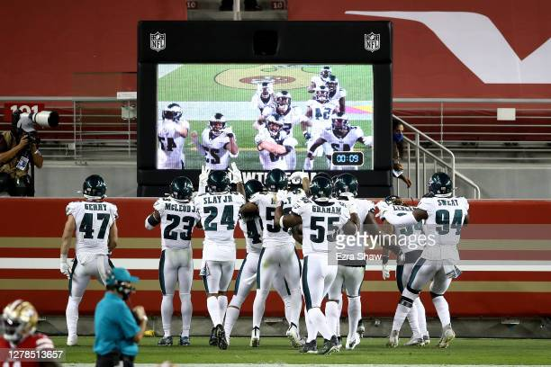 The Philadelphia Eagles celebrate in the end zone after the pick six by Alex Singleton in the fourth quarter against the San Francisco 49ers in the...