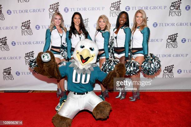The Philadelphia Eagles Cheerleaders and their team mascot Swoop attend the 33rd Annual Great Sports Legends Dinner which raised millions of dollars...