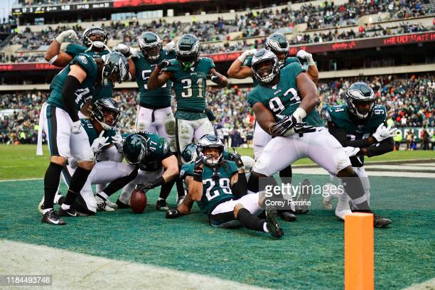 The Philadelphia Eagles defense flexes after a fumble turnover during the fourth quarter at Lincoln Financial Field on November 24, 2019 in...