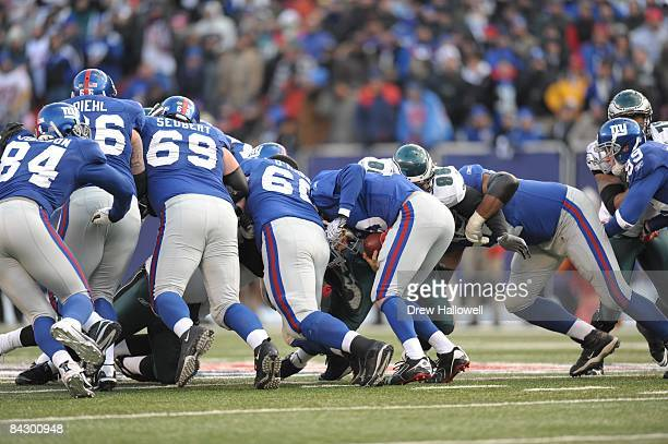 The Philadelphia Eagles defense stops quarterback Eli Manning of the New York Giants on fourth and inches on January 11 2009 at Giants Stadium in...
