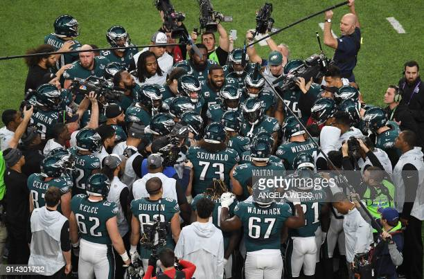TOPSHOT The Philadelphia Eagles huddle prior to the start of Super Bowl LII against the New England Patriots at US Bank Stadium on February 4 2018 in...