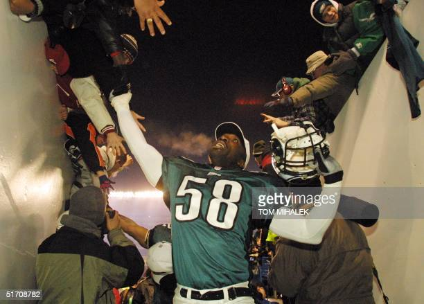 The Philadelphia Eagles Ike Reese greets joyous fans as he leaves the field after the Eagles 2421 win over the New York Giants with a 34 yard field...