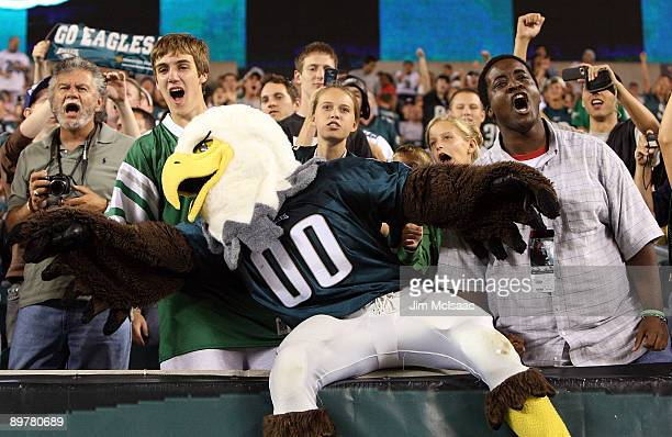 The Philadelphia Eagles mascot 'Swoop' celebrates with fans after a touchdown against the New England Patriots on August 13 2009 at Lincoln Financial...