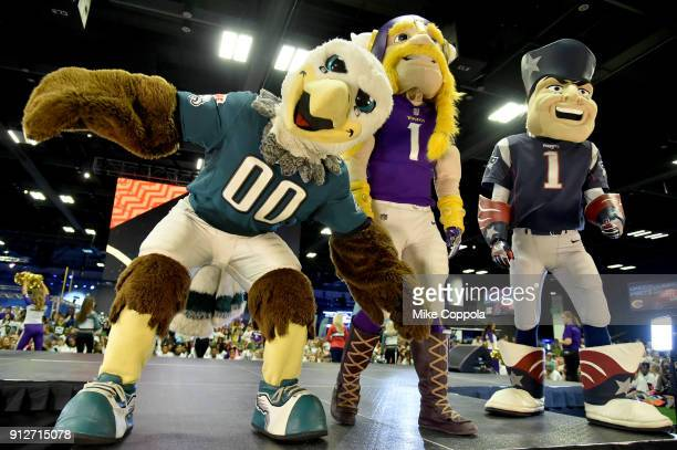 The Philadelphia Eagles Minnesota Vikings and New England Patriots mascots are seen onstage before the JoJo Siwa performs at Nickelodeon at the Super...