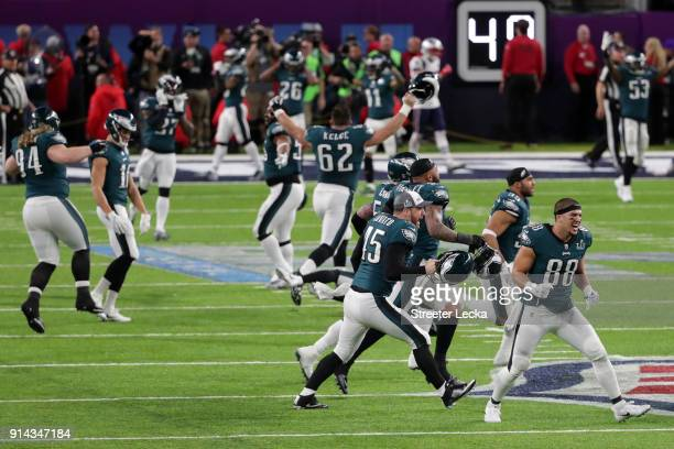 The Philadelphia Eagles run on the field after defeating the New England Patriots in Super Bowl LII at US Bank Stadium on February 4 2018 in...