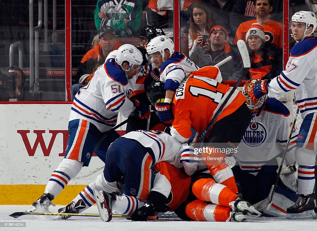 The Philadelphia Flyers and the Edmonton Oilers mix it up during the third period at the Wells Fargo Center on March 3, 2016 in Philadelphia, Pennsylvania. The Oilers shutout the Flyers 4-0.