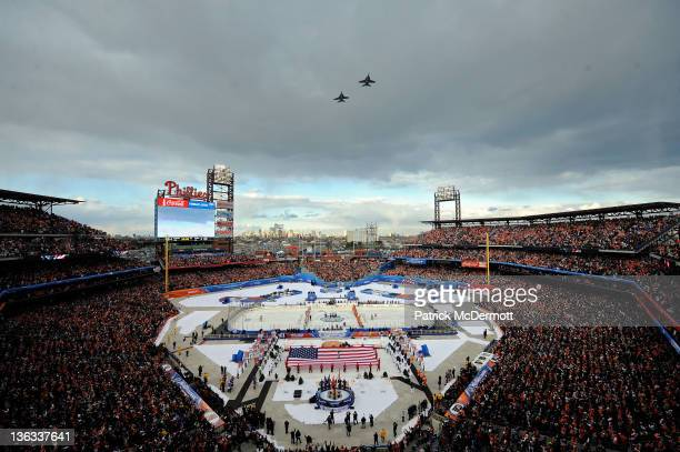 The Philadelphia Flyers and the New York Rangers line up for the National Anthem as US Air Force fighter jets fly over during the 2012 Bridgestone...
