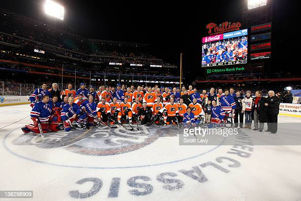 The Philadelphia Flyers and the New York Rangers pose for a joint team photo at Citizens Bank Park during the 2012 Bridgestone NHL Winter Classic...