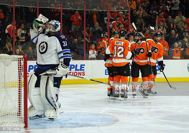 The Philadelphia Flyers celebrate a goal by Mark Streit at 41 seconds of the second period against Ondrej Pavelec of the Winnipeg Jets at the Wells...