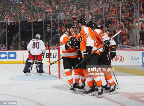 The Philadelphia Flyers celebrate a power-play goal by Jakub Voracek at 10:14 of the third period against the Columbus Blue Jackets as Claude Giroux...