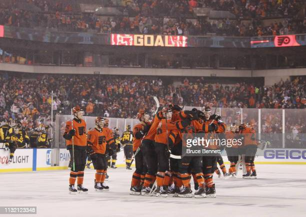 The Philadelphia Flyers celebrate the overtime win over the Pittsburgh Penguins during the 2019 Coors Light NHL Stadium Series game at the Lincoln...