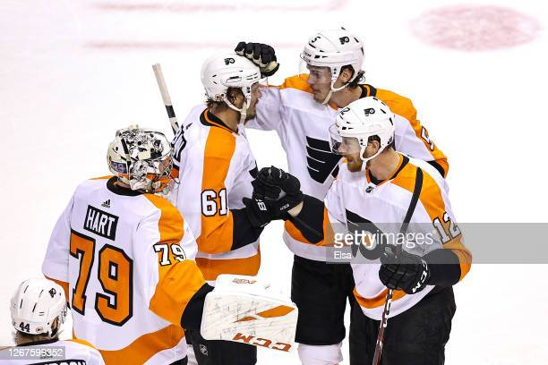 The Philadelphia Flyers celebrate their 3-2 win against the Montreal Canadiens in Game Six of the Eastern Conference First Round during the 2020 NHL...