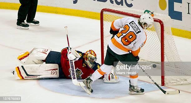 The Philadelphia Flyers' Claude Giroux puts his shot past Florida Panthers goalie Scott Clemmensen in the shootout at Bank Atlantic Center in Sunrise...