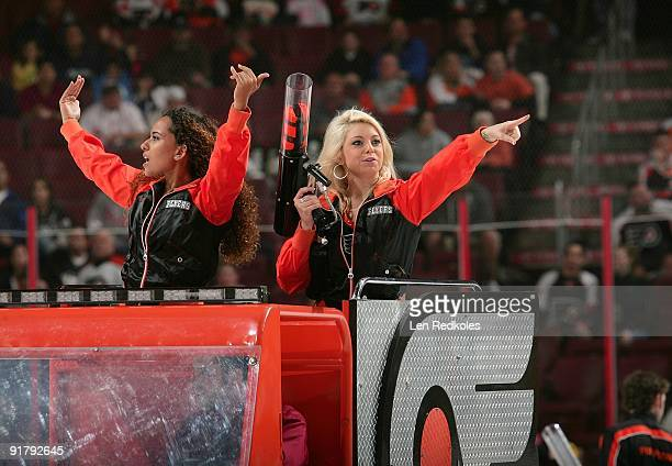 The Philadelphia Flyers ice girls prepare to shoot TShirts into the crowd during the first period intermission against the Pittsburgh Penguins on...