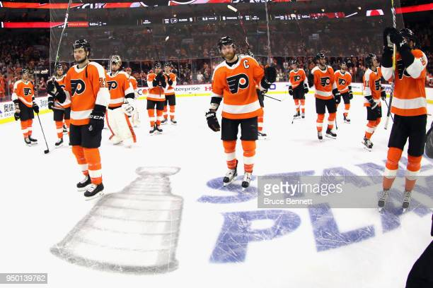 The Philadelphia Flyers leave the ice following a 85 loss to the Pittsburgh Penguins in Game Six of the Eastern Conference First Round during the...