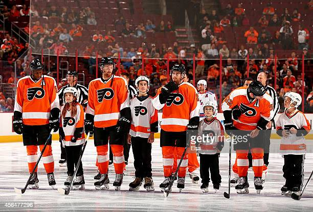 The Philadelphia Flyers line up for the national anthem before the game against the New York Rangers on September 30 2014 at the Wells Fargo Center...