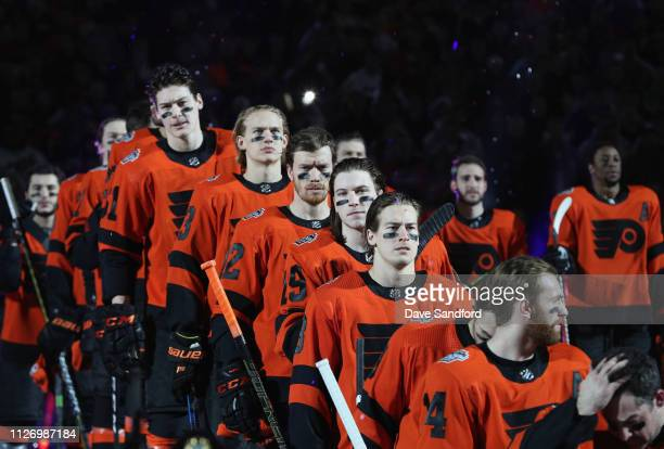The Philadelphia Flyers line up for the singing of the National Anthem prior to the 2019 Coors Light NHL Stadium Series game between the Pittsburgh...