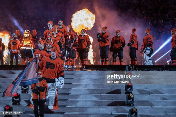 The Philadelphia Flyers line up on the stage for introductions before the Stadium Series game between the Pittsburgh Penguins and the Philadelphia...