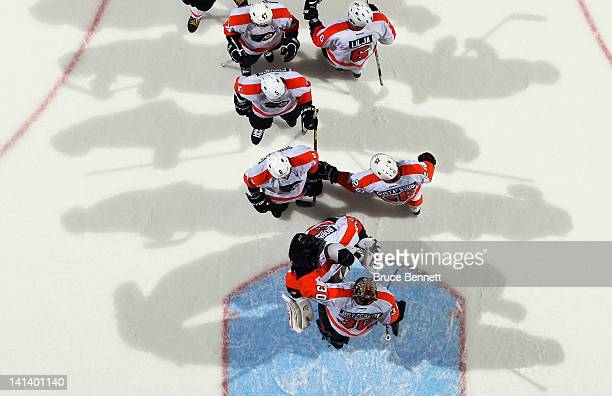 The Philadelphia Flyers line up to congratulate Ilya Bryzgalov on a 32 victory over the New York Islanders at the Nassau Veterans Memorial Coliseum...