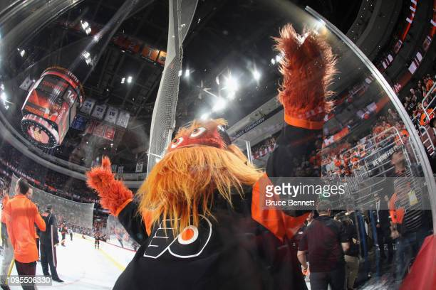 The Philadelphia Flyers mascot Gritty celebrates a Flyers goal against the Boston Bruins at the Wells Fargo Center on January 16 2019 in Philadelphia...