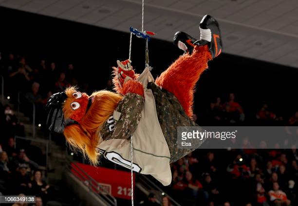 The Philadelphia Flyers mascot Gritty flies down onto the ice before the game between the Philadelphia Flyers and the Chicago Blackhawks at Wells...