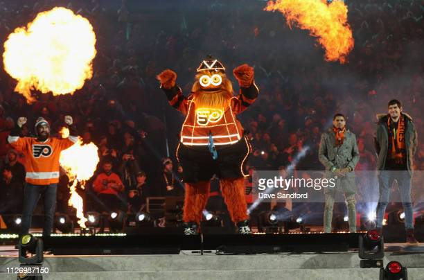 The Philadelphia Flyers mascot Gritty reacts after rappeling down to the ice before the 2019 Coors Light NHL Stadium Series game between the...