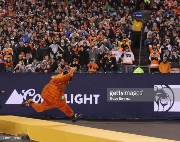 The Philadelphia Flyers mascot Gritty runs through the infield during the game against the Pittsburgh Penguins during the 2019 Coors Light NHL...