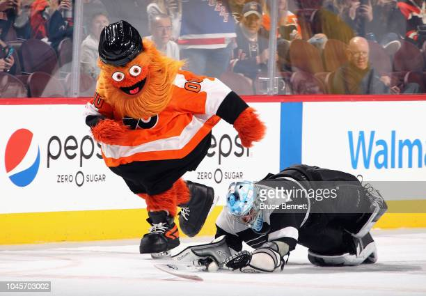 PHILADELPHIA PENNSYLVANIA SEPTEMBER 27 The Philadelphia Flyers mascot Gritty skates between periods of the game against the New York Rangers at the...