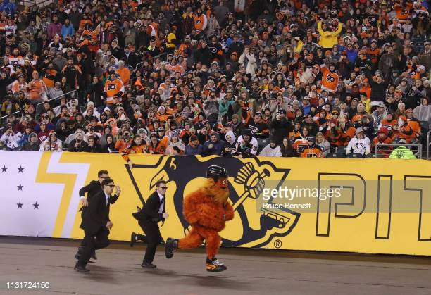 The Philadelphia Flyers mascot Gritty streaks across the field during the game between the Philadelphia Flyers and the Pittsburgh Penguins during the...