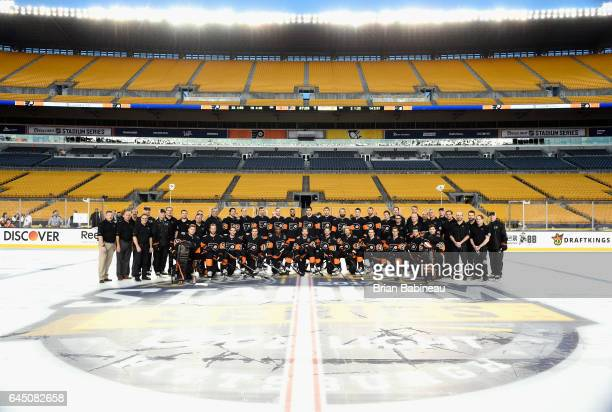 The Philadelphia Flyers pose for a team photo at center ice prior to practice for the 2017 Coors Light NHL Stadium Series game to be played between...