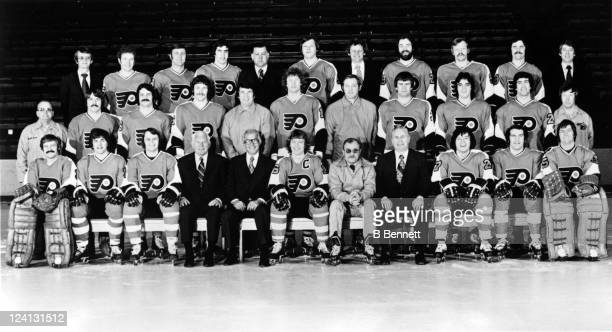 The Philadelphia Flyers pose for a team photo circa 197677 in Philadelphia Pennsylvania Front Row LR Bernie Parent Gary Dornhoefer Bill Barber...