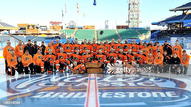 The Philadelphia Flyers pose for a team photo during the 2012 Bridgestone NHL Winter Classic Practice Sessions at Citizens Bank Park on January 1...