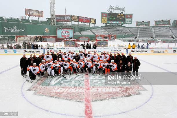 The Philadelphia Flyers pose for a team photo on the ice during practice prior to Bridgestone's presentation of 2010 NHL Winter Classic at Fenway...