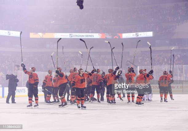 The Philadelphia Flyers salute their fans at center ice after their overtime win on a goal by Claude Giroux during the 2019 Coors Light NHL Stadium...