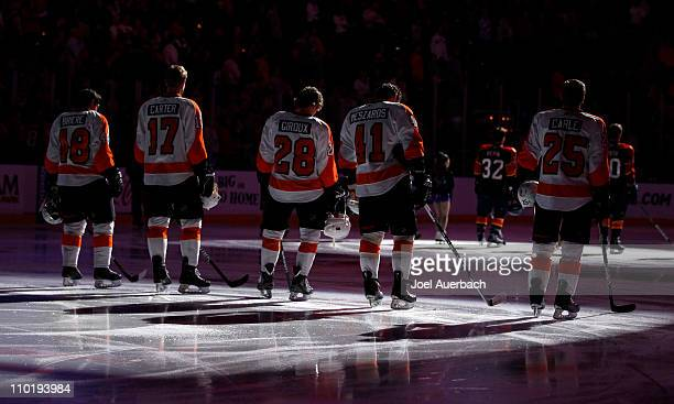 The Philadelphia Flyers starting line up stands at the blue line for the playing of the national anthem prior to the game against the Florida...