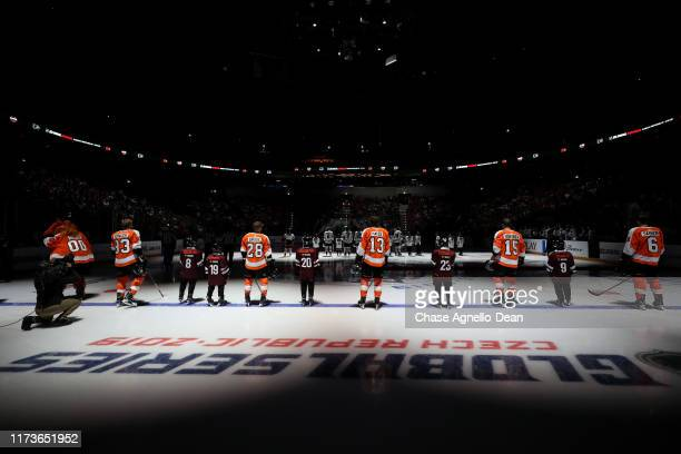 The Philadelphia Flyers starting lineup stands on the ice for the national anthem prior to the NHL Global Series Challenge 2019 match against the...