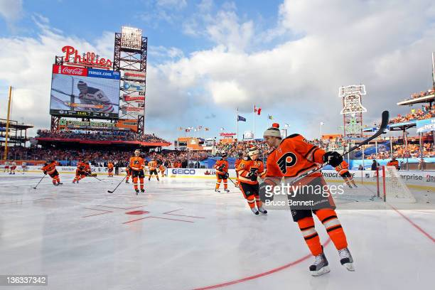 The Philadelphia Flyers warm up prior to playing against the New York Rangers during the 2012 Bridgestone NHL Winter Classic at Citizens Bank Park on...