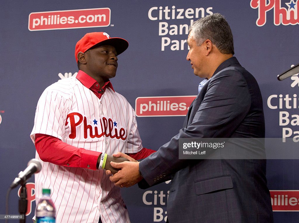 The Philadelphia Phillies 2015 first round pick Cornelius Randolph #2 shakes hands with Phillies Director of Amateur Scouting Johnny Almaraz at a news conference prior to the game against the Baltimore Orioles on June 17, 2015 at the Citizens Bank Park in Philadelphia, Pennsylvania.