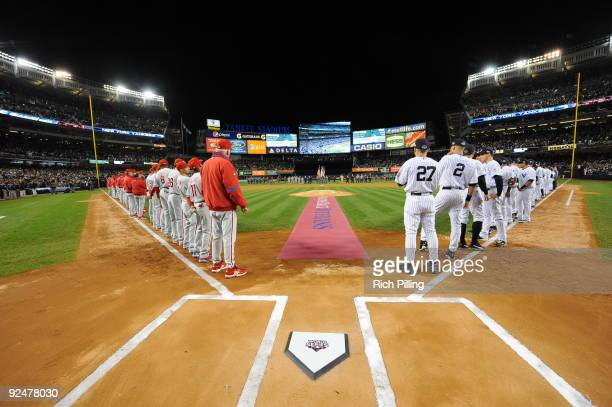 The Philadelphia Phillies and the New York Yankees line up on the field prior to Game 1 of the 2009 World Series between the Philadelphia Phillies...