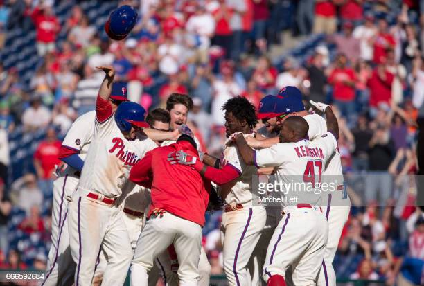 The Philadelphia Phillies celebrate after a walk off single hit by Cesar Hernandez of the Philadelphia Phillies in the bottom of the ninth inning...