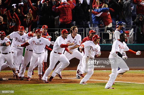 The Philadelphia Phillies celebrate after Carlos Ruiz scored the winning run on a walkoff 2run double by Jimmy Rollins in the bottom of the ninth...