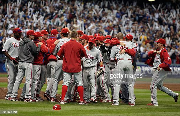 The Philadelphia Phillies celebrate after the final out against the Milwaukee Brewers in game four of the NLDS during the 2008 MLB playoffs at Miller...