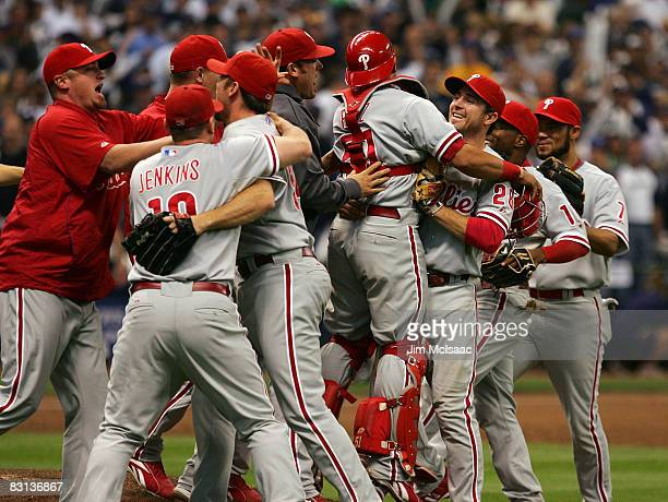 The Philadelphia Phillies celebrate the final out against the Milwaukee Brewers in game four of the NLDS during the 2008 MLB playoffs at Miller Park...