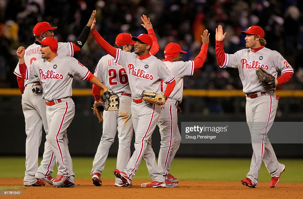 The Philadelphia Phillies celebrate their win over the Colorado Rockies during Game 3 of their National League Division series at Coors Field on October 11, 2009 in Denver, Colorado. The Phillies defeated the Rockies 6-5 in game 3 to take 2-1 lead in the series.
