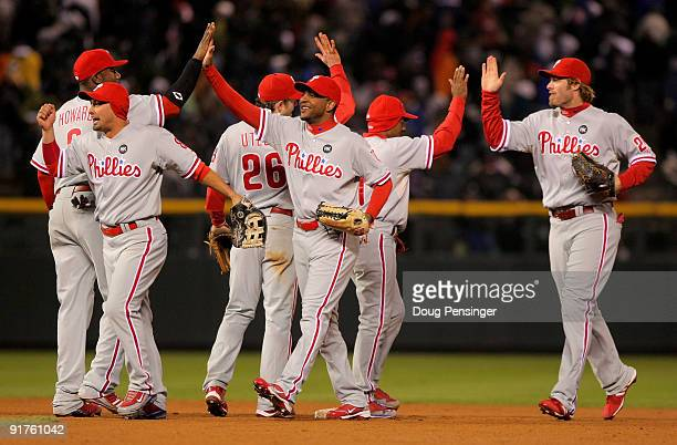 The Philadelphia Phillies celebrate their win over the Colorado Rockies during Game 3 of their National League Division series at Coors Field on...