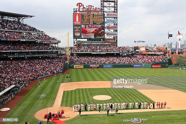 The Philadelphia Phillies line the first base line as they are honored during the Phillies 2008 World Series Championship Ring Ceremony before a game...