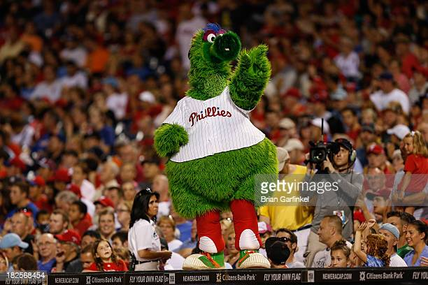 The Philadelphia Phillies mascot the Phillie Phanatic dances on top of the dugout in between innings of the second game of a double header against...