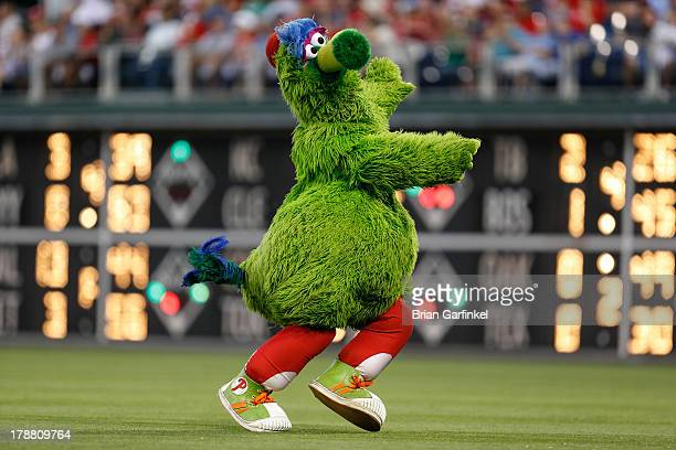 The Philadelphia Phillies mascot the Phillies Phanatic 'streaks' in the outfield in between innings of the game against the Washington Nationals at...