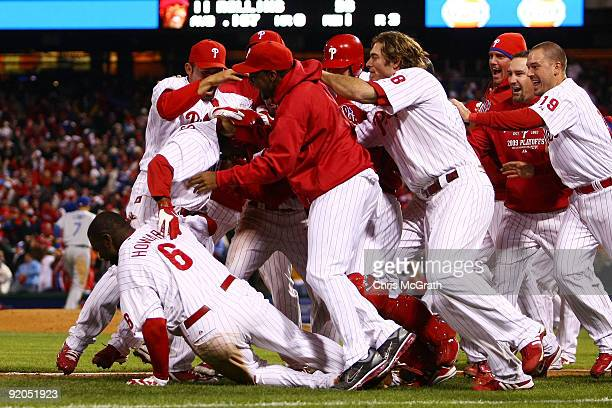 The Philadelphia Phillies pile on Jimmy Rollins after Rollins hit a gamewinning walkoff 2run double in the bottom of the ninth inning to win 54...